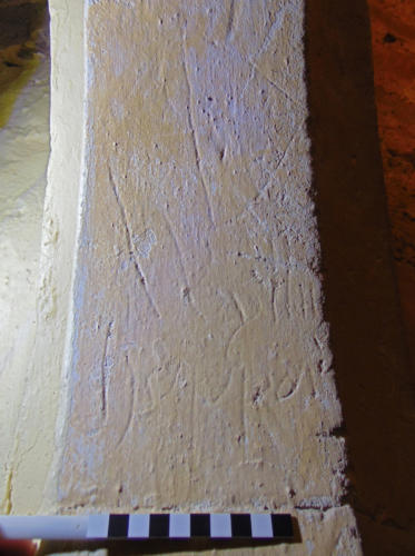 7. Name, possibly Wylliam Heydjon, with cross above. Ringing chamber doorway.