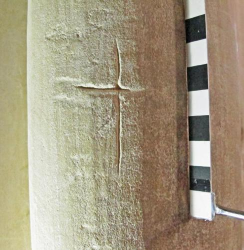 1. Deeply carved cross. North aisle pier.