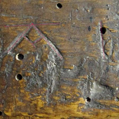 3. A with v shaped crossbar, & ?letter I. Possible Marian reference. Chancel screen.