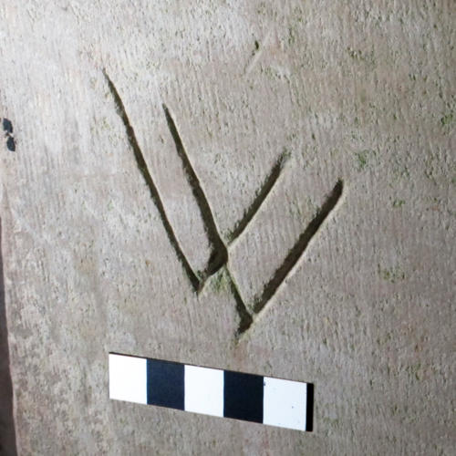 2. W or V V symbol. South doorway.