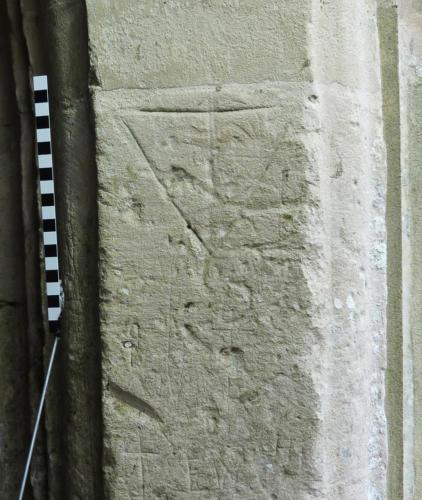 3. Triangle; crosses; letters. North porch.