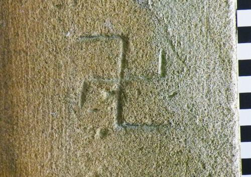 4. Detail of reversed swastika type symbol. South doorway.