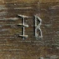 4. Letters I B. Probably initials. Lady Chapel screen.