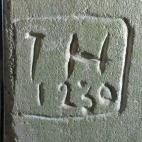 4.  Assumed initials I H & date 1230.  ?Reference to founding of church. South doorway.