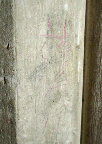 7. Figure with tall hat, facing left. Highlighted. North aisle pier.