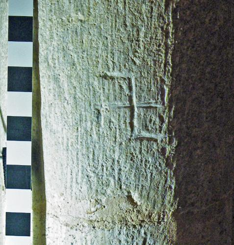 6. Reversed swastika type symbol. North aisle pier.