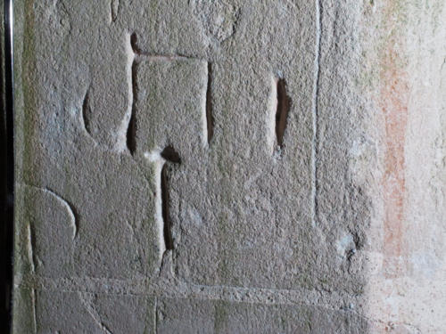 6. ?Symbol & letters. South doorway.