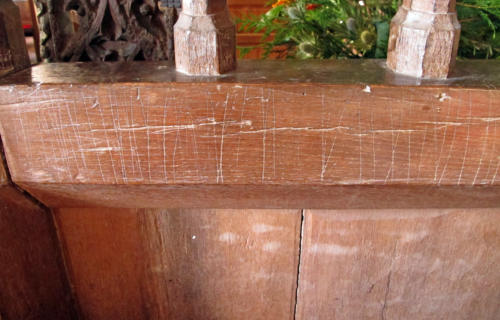 7. Series of vertical score marks. Rood screen.