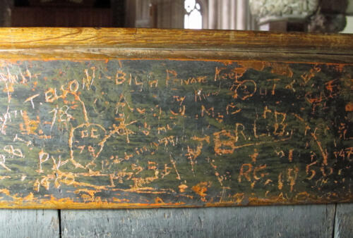8. Modern graffiti on choir stall.