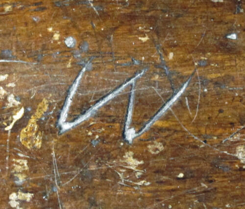 3. Lone letter W. South aisle bench.