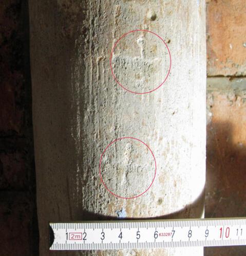 3. Porch, W. side pillar. Two feint crosses.