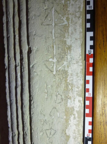 7. South doorway. Double ended arrows (probably apotropaic), and other marks.