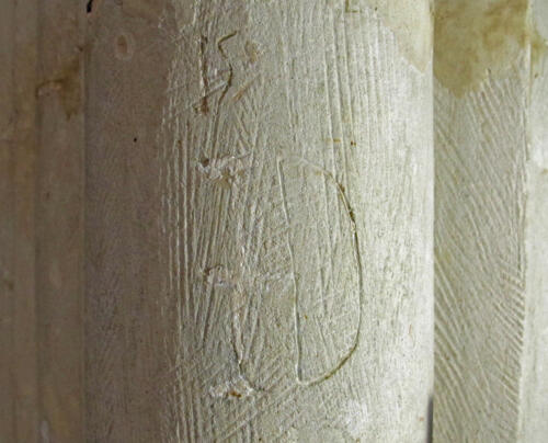 9. S. aisle pier. Letter I (crossed) or J, with remnants of limewash,  and D.
