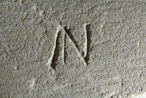 4. Letter ?N on the shield of the north-eastern effigy.