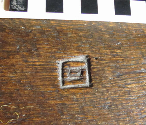 10.  Nave bench. Concentric square or stylised G.
