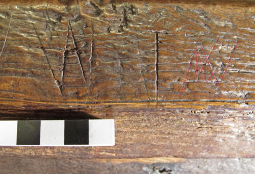 9. Nave bench. Letters W I,  followed by feint (highlighted) V or W marks.