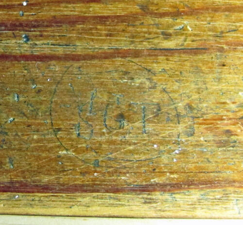 3. Initials S.G.T on bench.