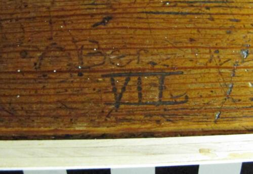 6. Roman numerals on bench.